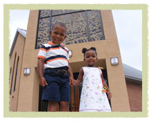 little boy and girls in front of St. Martin de Porres Catholic Church